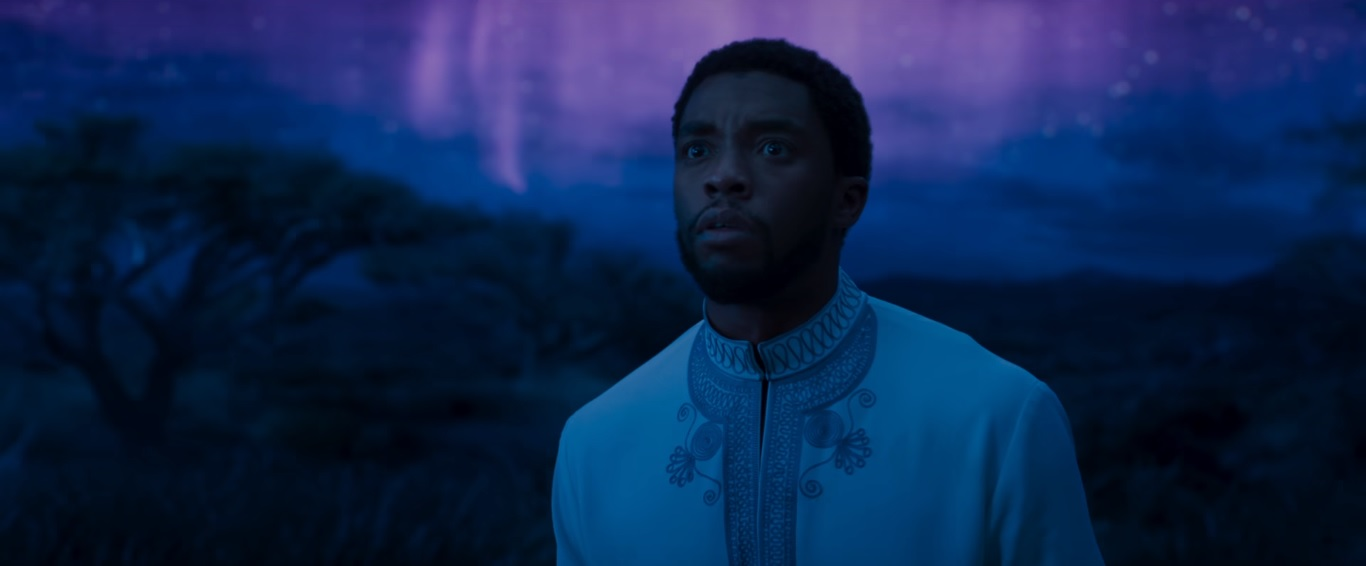 T'Challa in the land of the ancestors, which looks like the African Savannah amid a mysterious blue and purple sky.
