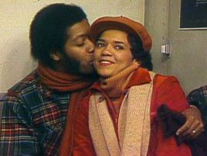 David kisses Maria on the cheek in a 1970s episode of Sesame Street.