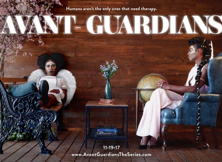 Razz, an angle with afro puffs and combat boots, sits in a wood-paneled office with her feet on a desk. opposite her, her guardian angel therapist, wearing a long braid with gold entwined and a stark white jumpsuit, sits patiently, waiting to her her complaints.