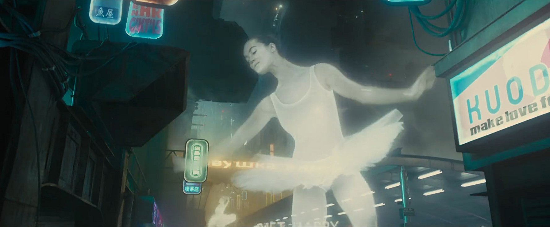 "An advertisement for Russia featuring a huge holographic ballerina dancing while the words ""Soviet Happy"" circle around her legs."