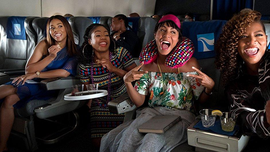 Regina Hall, Tiffany Haddish, Jada Pinkett Smith, and Queen Latifah have fun on an airplane in Girls Trip.