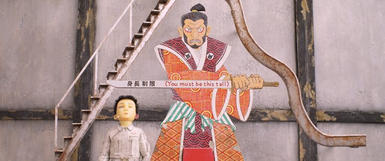 "Atari (Koyu Rankin) stands under a Samurai sign that reads ""You Must Be This Tall"""