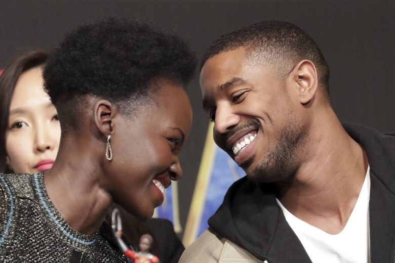 Lupita Nyong'o and Michael B. Jordan gaze at each other during the Korean press conference for Black Panther.