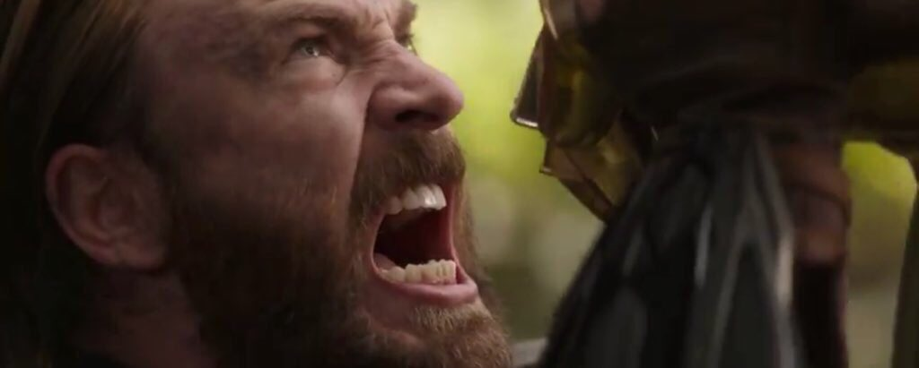 Captain America attempting to hold back Thanos' gauntlet.