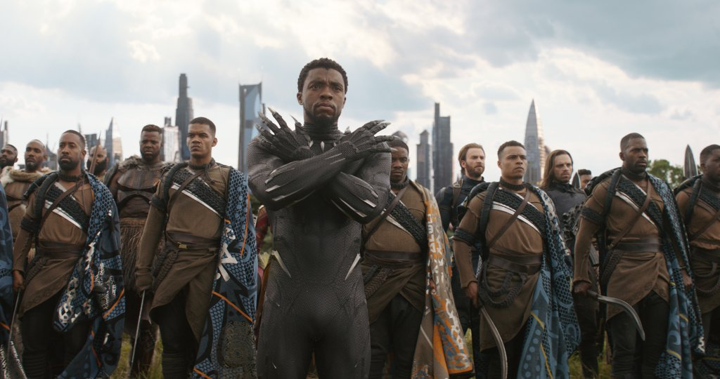 T'Challa in his Black Panther uniform stands with his army in Wakanda.