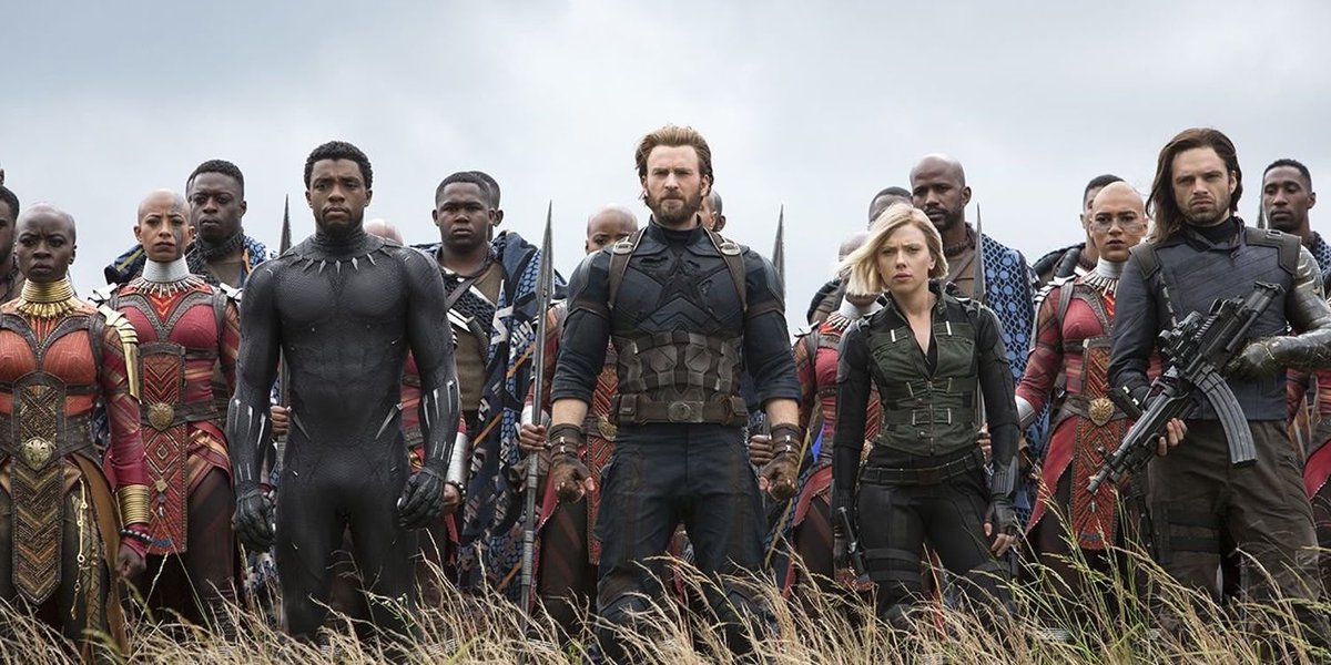 Okoye, Black Panther, Captain America, Black Widow, and Bucky stand in front of an army of Wakandan soldiers.