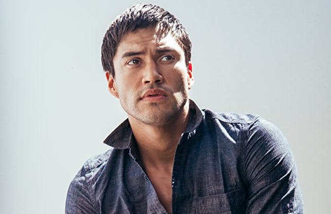 Martin Sensmeier in a denim shirt.