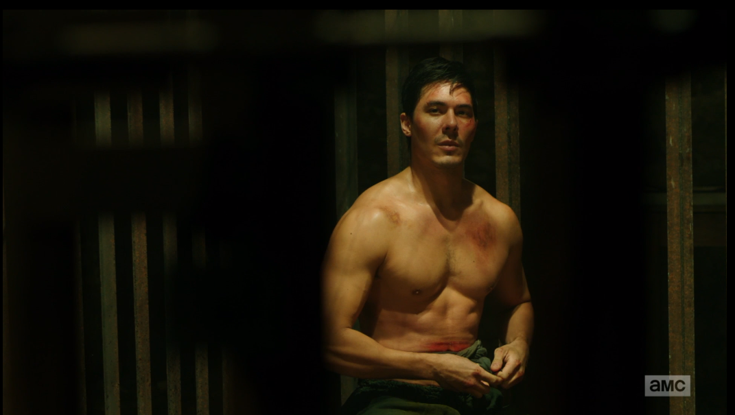 Shirtless Lewis Tan in a prison cell on Into the Badlands.