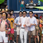 "Photo Credit: Sanja Bucko Caption: (Front L-R) (with girl in blue bikini) RONNY CHIENG as Eddie, JIMMY O. YANG as Bernard, CHRIS PANG as Colin, REMY HII as Alistair and HENRY GOLDING as Nick in Warner Bros. Pictures' and SK Global Entertainment's and Starlight Culture's contemporary romantic comedy ""CRAZY RICH ASIANS,"" a Warner Bros. Pictures release."