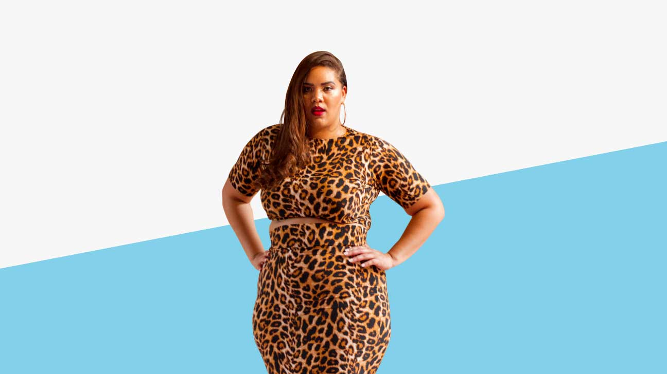A Latina plus-sized model is wearing a leopard print two piece top and skirt set.