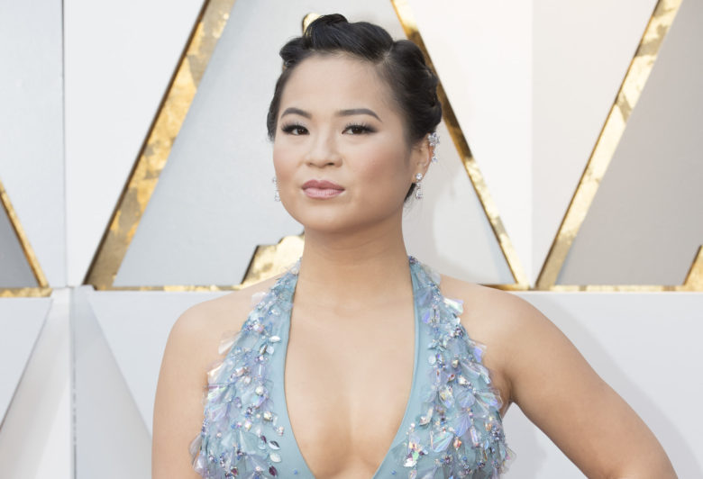 Kelly Marie Tran in a light blue gown with plunging halter neckline at the 2018 Oscars.