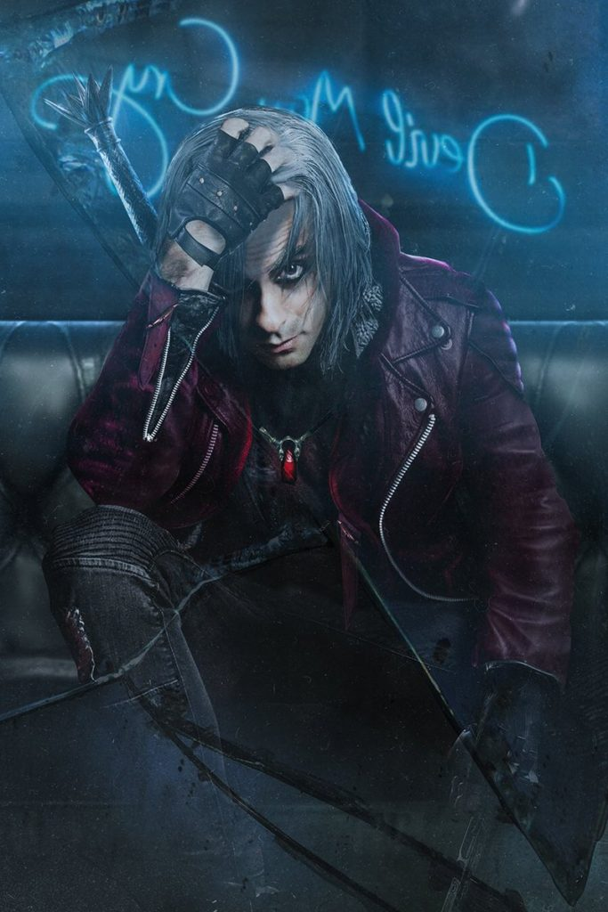 Adi Shankar as Dante from Devil May Cry. A neon sign for Devil May Cry is in the background.