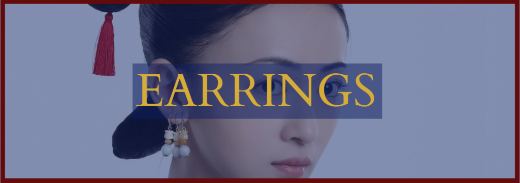 """Wu Jinyan as Wei Ying Luo, wearing three pairs of triple-drop earrings. An overlay of blue is over the picture, with """"EARRINGS"""" in gold capital letters."""