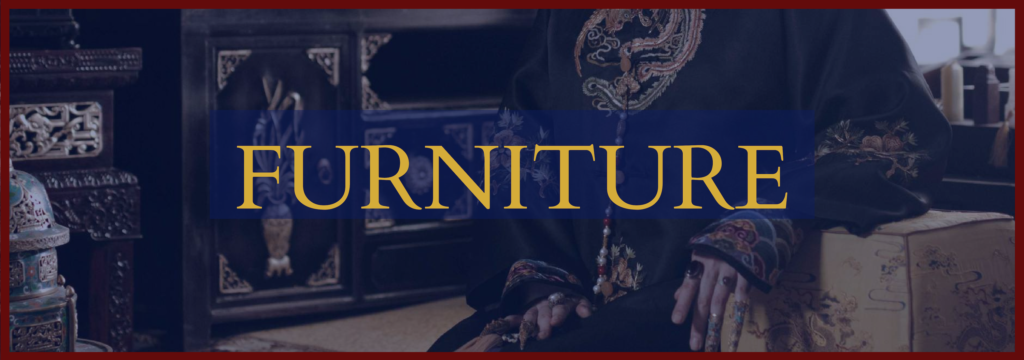 """A closeup shot of black and a gold-lacquered cabinet. An overlay of blue is over the picture, with """"FURNITURE"""" in gold capital letters."""