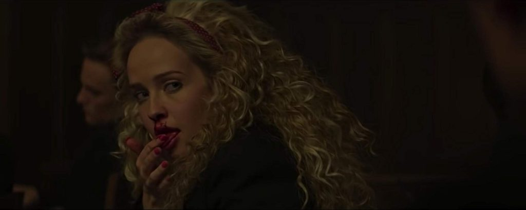 Siobhan Williams as Brandy Lynn. She licks the blood that's trailing from her nose.