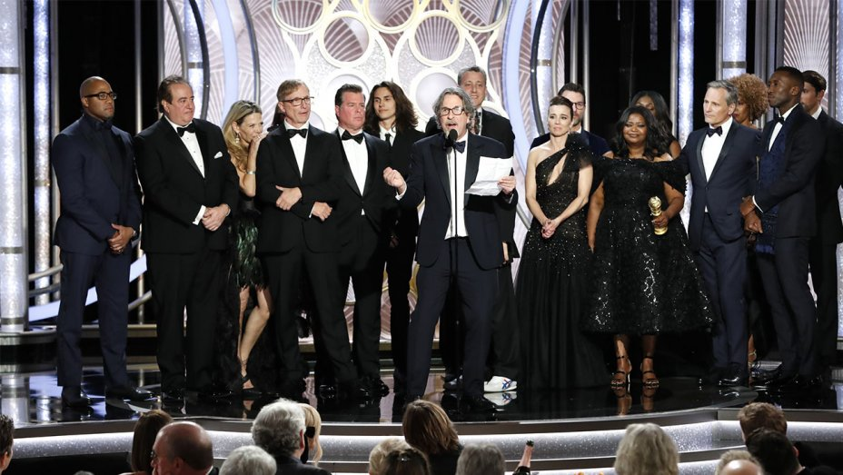 The cast and crew of Green Book accept their award.