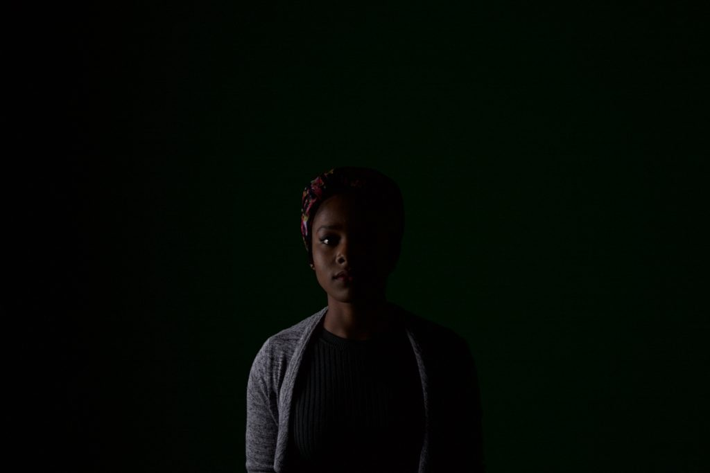 """""""I needed to take a photo of someone I was familiar with, so I asked my roommate. With a packet of biscuits as payment she agreed to sit and let me and my camera delve deep""""--Olayinka Babalola"""