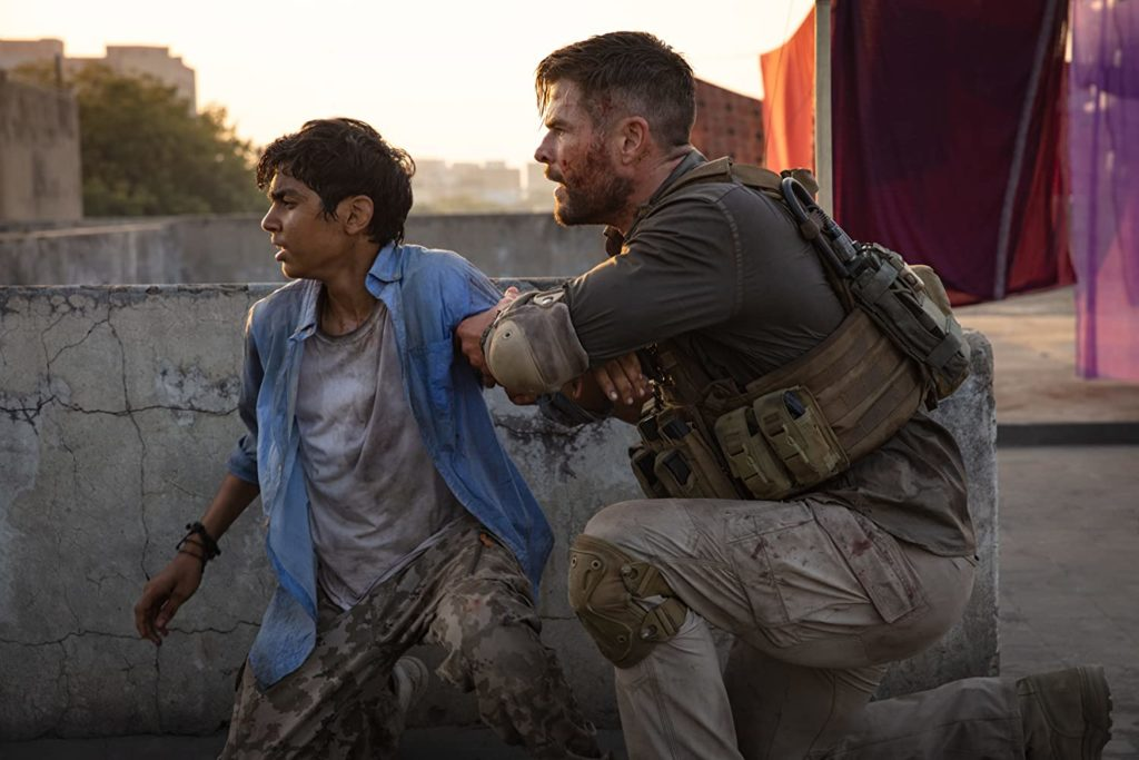 (R-L) Chris Hemsworth and Rudhraksh Jaiswal in Extraction. Photo credit: Jasin Boland/Netflix