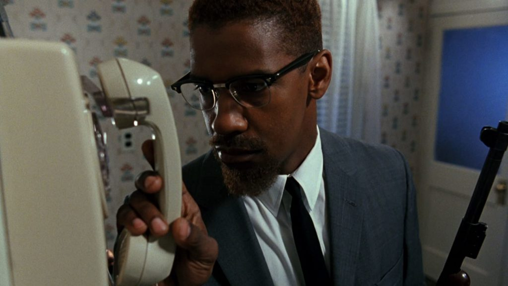 Denzel Washington in Malcolm X. Photo credit: 40 Acres and a Mule Filmworks, Warner Bros. This is one of the 30 films Redbox recommends to learn about systemic racism.