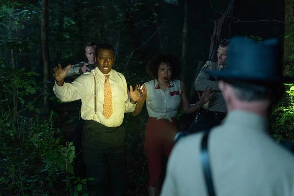 Uncle George (Courtney B. Vance) and Leticia (Jurnee Smollett) targeted by racist sheriffs. (Photo credit: HBO)