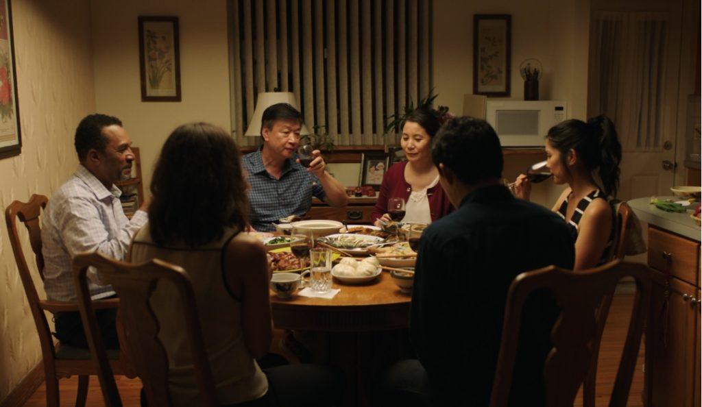 Clifton Davis, Tzi Ma, Fiona Fu, Lynn Chen, Kenny Leu and Ciara Renée at the kitchen table in A Shot Through The Wall. (Photo credit: Aimee Long)