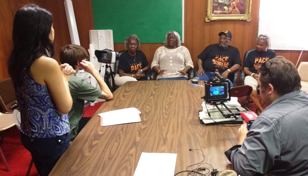 (L-R) The crew of Far East Deep South, Larissa Lam, director, Patrick Wilkerson, camera, and Jason Rochelle, camera film residents of Pace, MS, discussing the important relationship between the African-American and Chinese communities in the Mississippi Delta