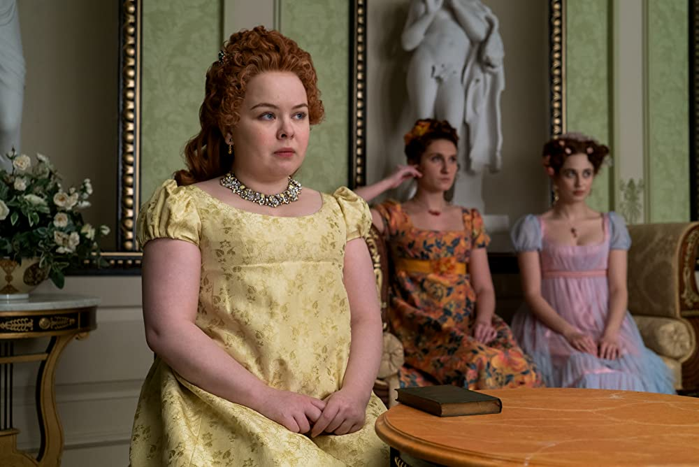 Penelope Featherington (Nicola Coughlan) with her sisters Prudence (Bessie Carter) and Philipa (Harriet Cains). (Photo credit: Liam Daniel/Netflix)