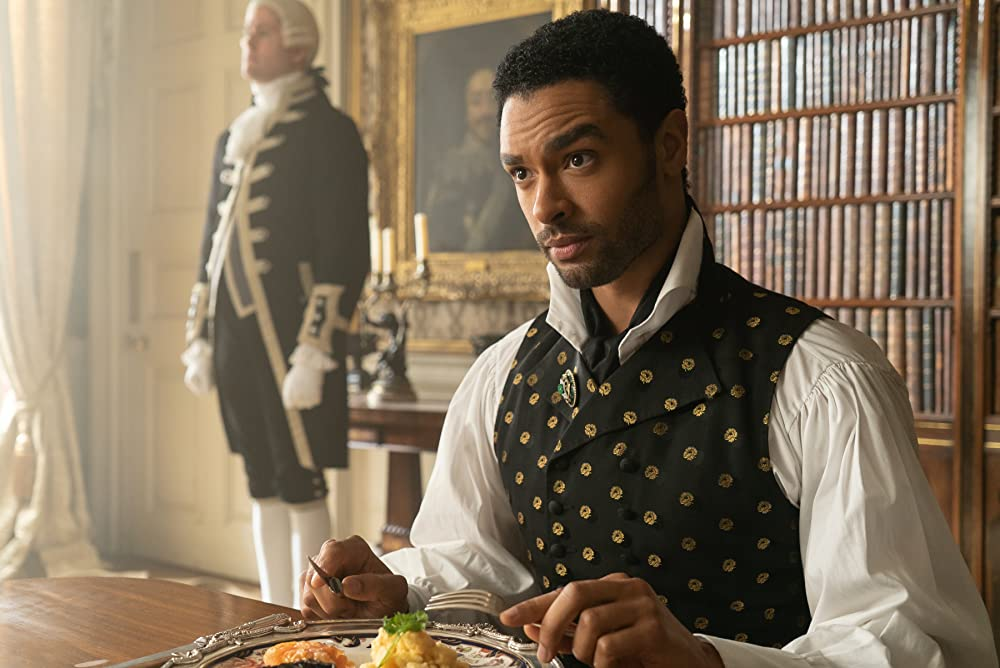Simon (Regé-Jean Page) eating his Lordly meal. (Photo credit: Liam Daniel/Netflix)
