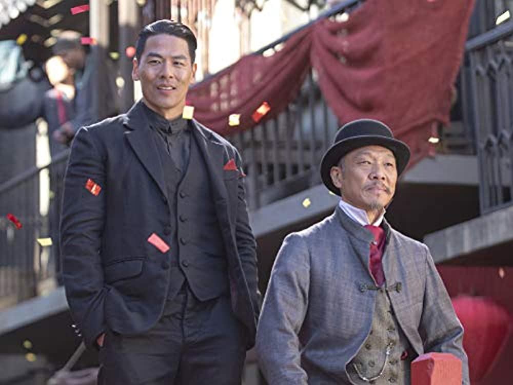 Rich Ting as Hop Wei hatchet man Bolo and Perry Yung as Father Jun. (Photo credit: Cinemax)