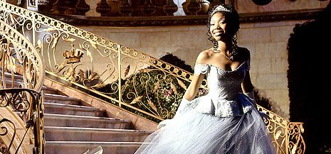 Brandy as Cinderella, posing on the stairs of the castle. (Photo credit: Disney)