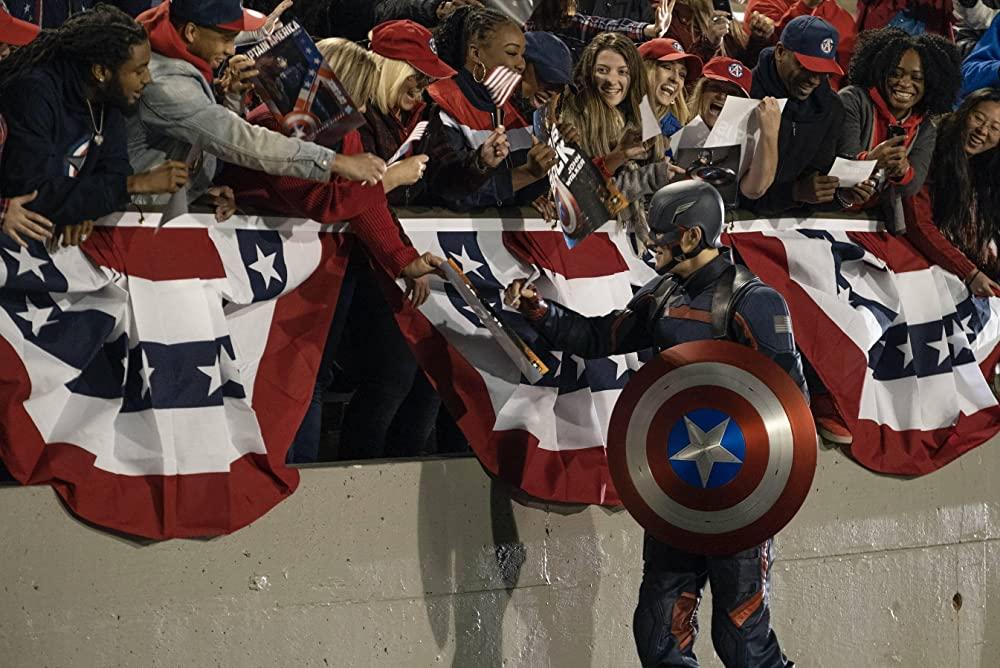 John Walker (Wyatt Russell) greeting the crowd as Captain America. (Disney+)