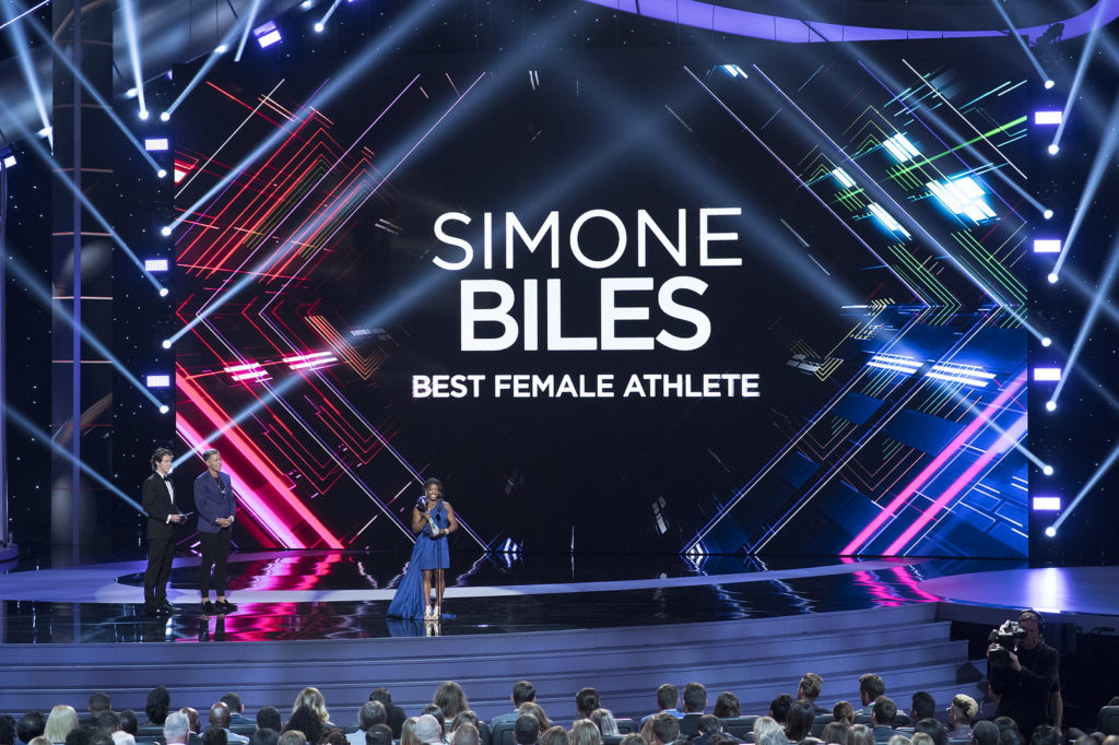 Simone Biles at the 2017 ESPYs, receiving the award for Best Female Athlete (ABC/Image Group LA [Creative Commons license])